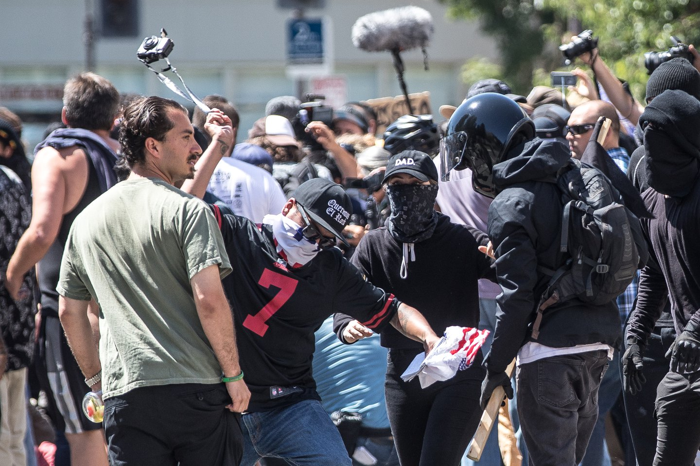 Protester about to smash Mike Kessler's camera at Berkeley