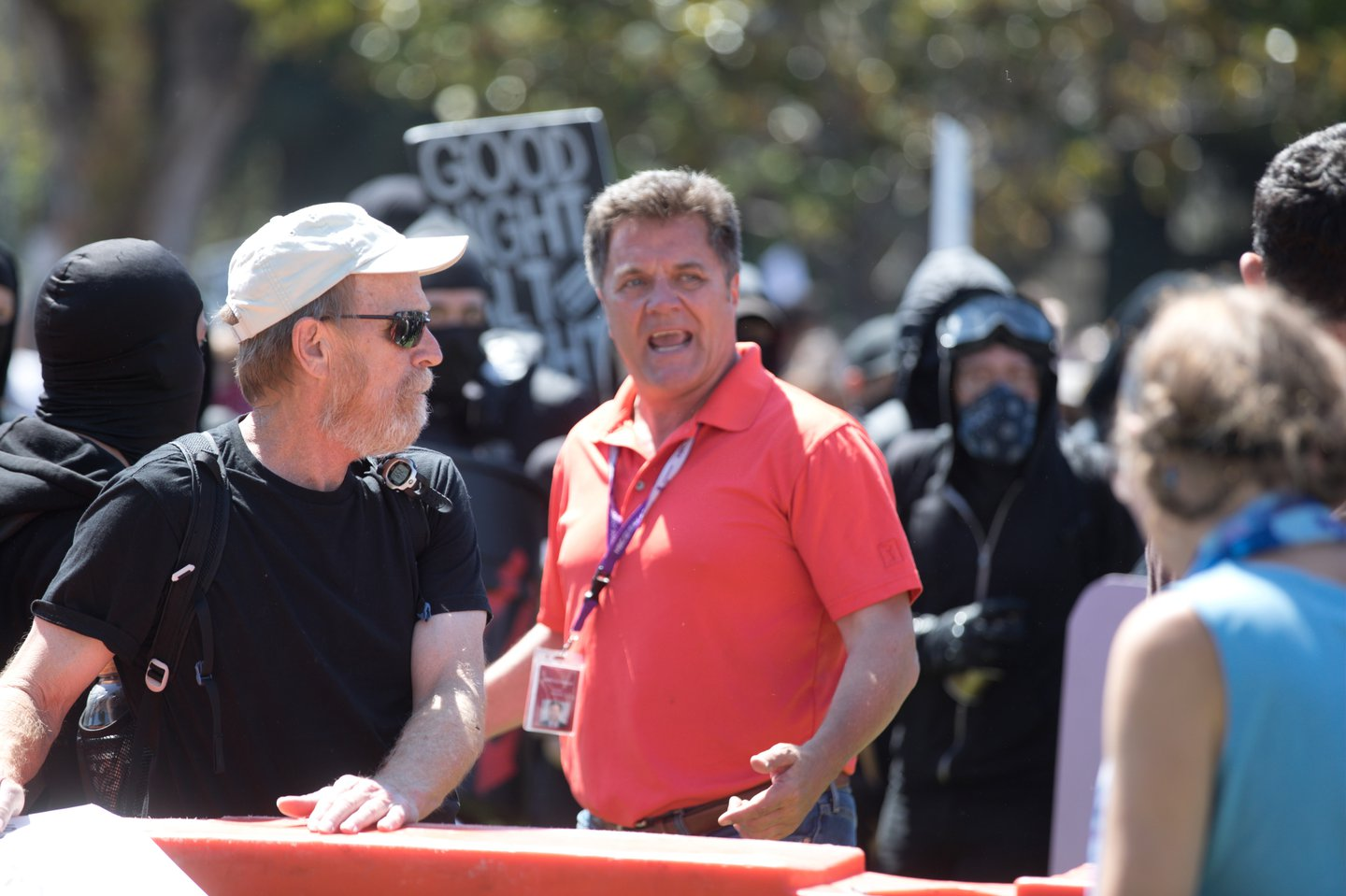 Thom Jensen argues with protesters