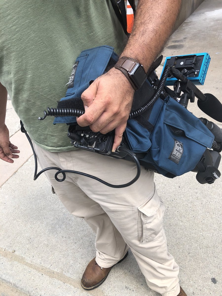 Gary Cooper holding broken camera