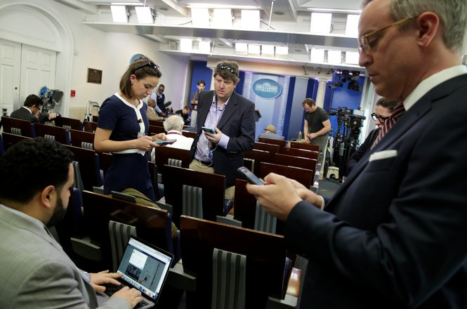 "Journalists work in the briefing room at the White House in Washington, U.S., February 24, 2017. Several major news organizations including CNN, The New York Times and Politico were excluded from an off camera ""gaggle"" meeting with White House Press Secre"