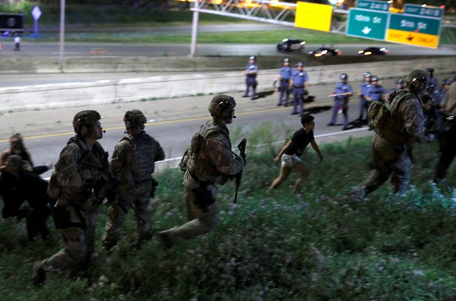 SWAT (Special Weapons and Tactics) teams move to arrest protesters during a gathering on Interstate 94 after a jury found St. Anthony Police Department officer Jeronimo Yanez not guilty of second-degree manslaughter in the death of Philando Castile, at th