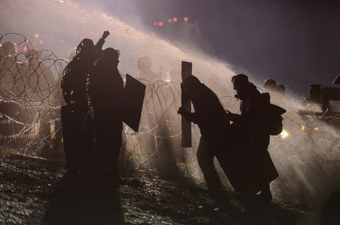Police use a water cannon on protesters