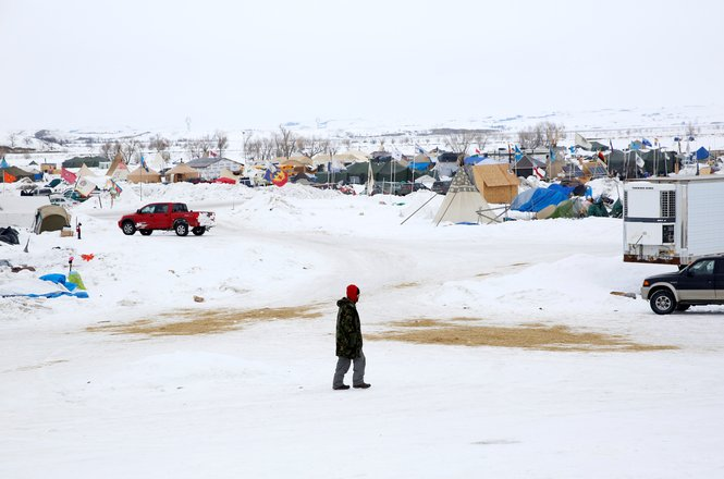 A man walks through the Dakota Access Pipeline protest camp on the edge of the Standing Rock Sioux Reservation near Cannon Ball, North Dakota, U.S., January 24, 2017.