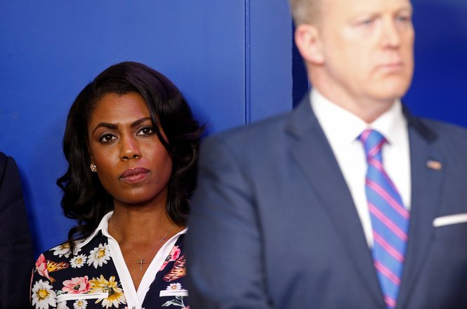 Omarosa Manigault (L), aide to U.S. President Donald Trump, stands beside White House spokesman Sean Spicer (R) at a press briefing at the White House in Washington, U.S., February 14, 2017.