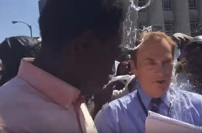 KTVI reporter Dan Gray hit with water