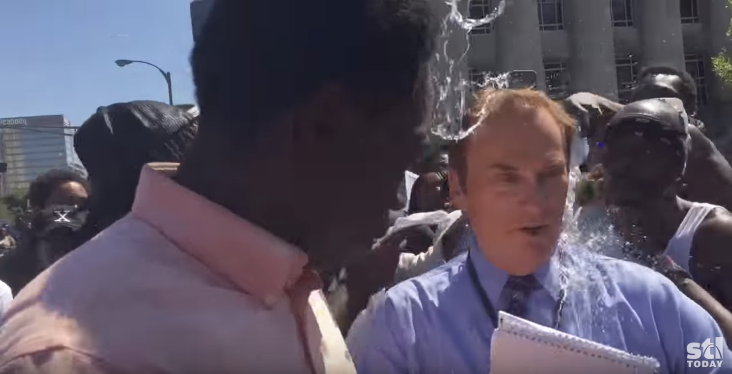 KTVI reporter Dan Gray hit with water