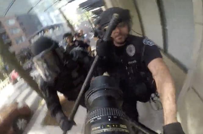 Doug Brown shoved by Portland police