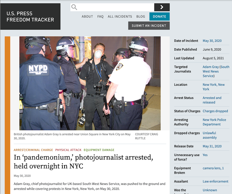 Photographer Gray arrested.png