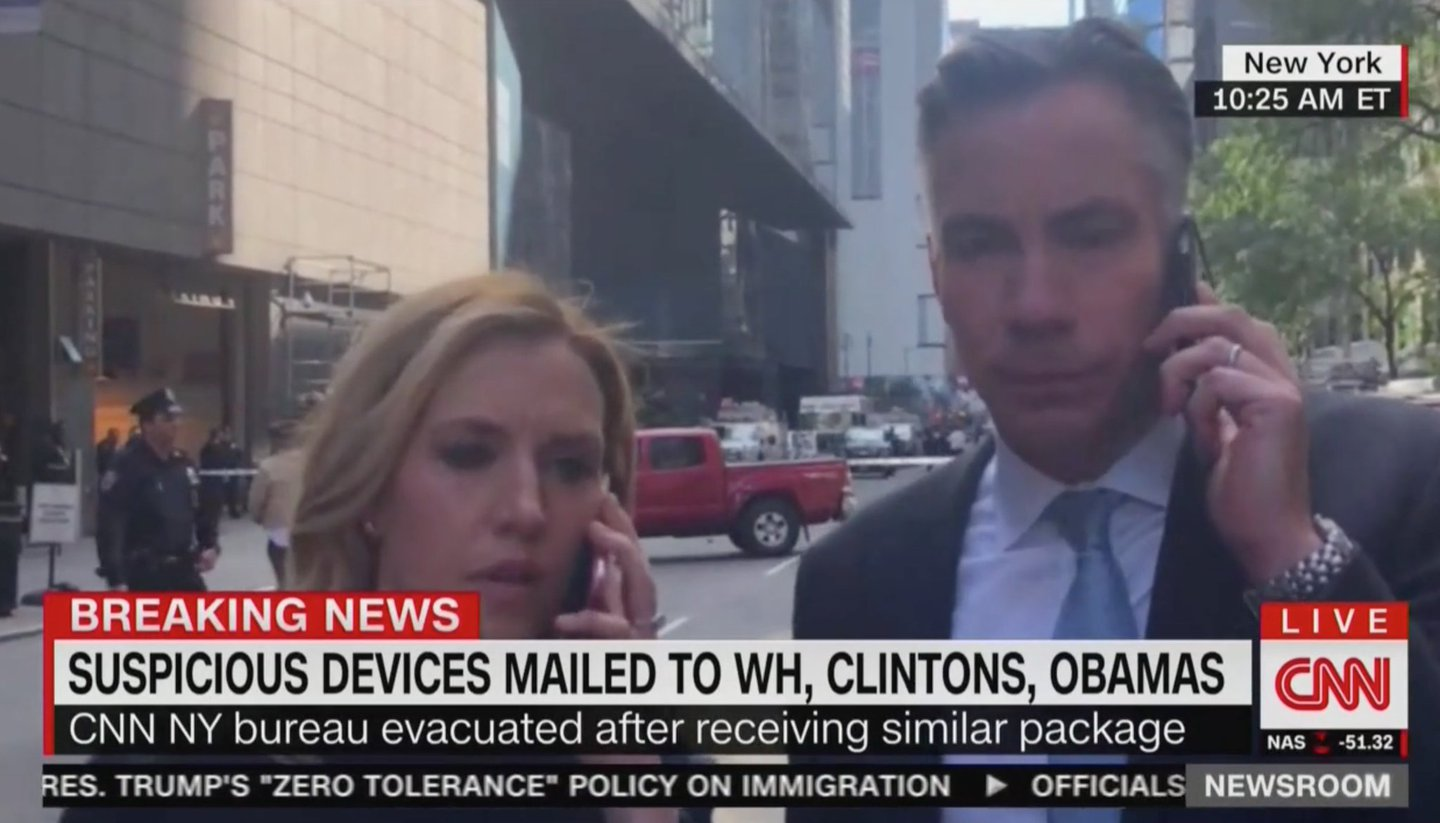 CNN's Poppy Harlow and Jim Sciutto outside Time Warner Center